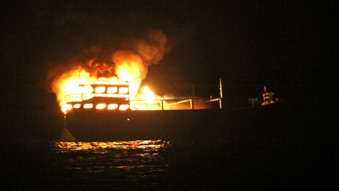 ht burning boat nt 120809 wblog U.S. Navy Rescues 10 From Iranian Ship on Fire