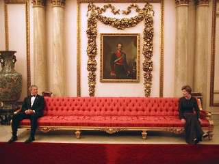 PHOTO: President George W. Bush and Mrs. Laura Bush sit on either ends of a couch prior to a social event at Buckingham Palace.