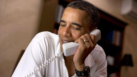 ht obama phone jef 111225 wblog Keeping the Tradition, Obama Calls Troops on Christmas Eve