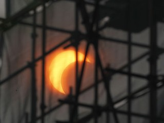PHOTO: A partial annular solar eclipse appears through construction scaffoldings in Beijing, China, Monday, May 21, 2012.