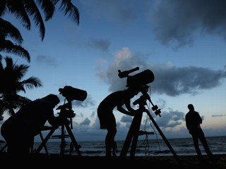 PHOTO: Telescopic cameras and computer equipment are set up on Palm Cove beach in preparation to run a live stream via NASA of the total solar eclipse on Nov. 13, 2012, in Cairns, Australia.