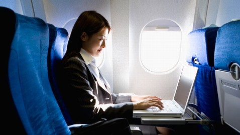 gty woman on plane window Seat thg 120425 wblog Best Seat on the Plane? Hint: Not in Row 7