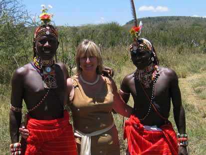 Safari wedding planner Meregan Turner got married in the Kenyan bush herself. Here, Samburu tribe warriors give her away at the ceremony.