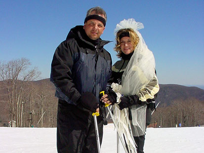 After a mountaintop wedding, these newlyweds prepare to celebrate the moment with a ski downhill.