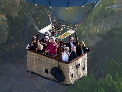 Though the wedding party is limited to eight, the sky is the limit for hot air balloon weddings at Up and Away in Sonoma Valley. Owner Mike Kijak, center, pilots the balloon and performs the ceremony.