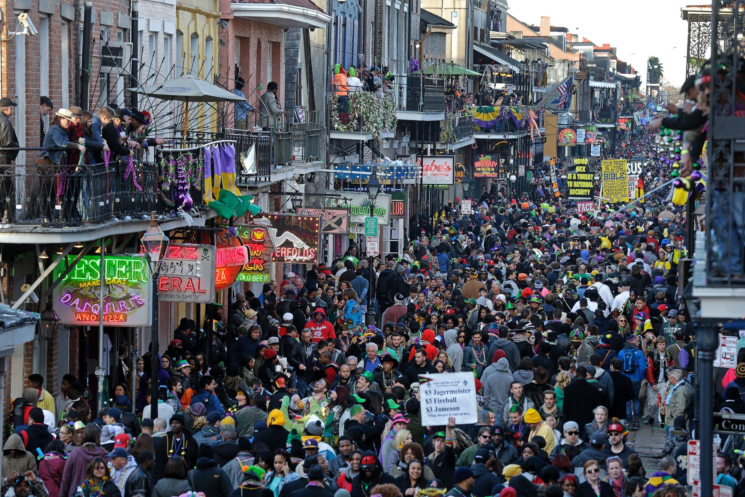 Revelers pack Bourbon Street beneath the balcony of the Royal Sonesta
