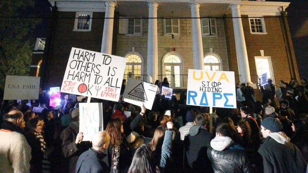 PHOTO: Protestors carry signs and chant slogans in front of the Phi Kappa Psi fraternity house at the University of Virginia on Nov. 22, 2014 in Charlottesville, Va.