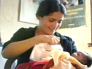 Actress Salma Hayek breastfeeds another mother's son in Sierra Leone to tout the benefits of breastfeeding in a country where it is frowned upon after the first few months of a baby's birth.