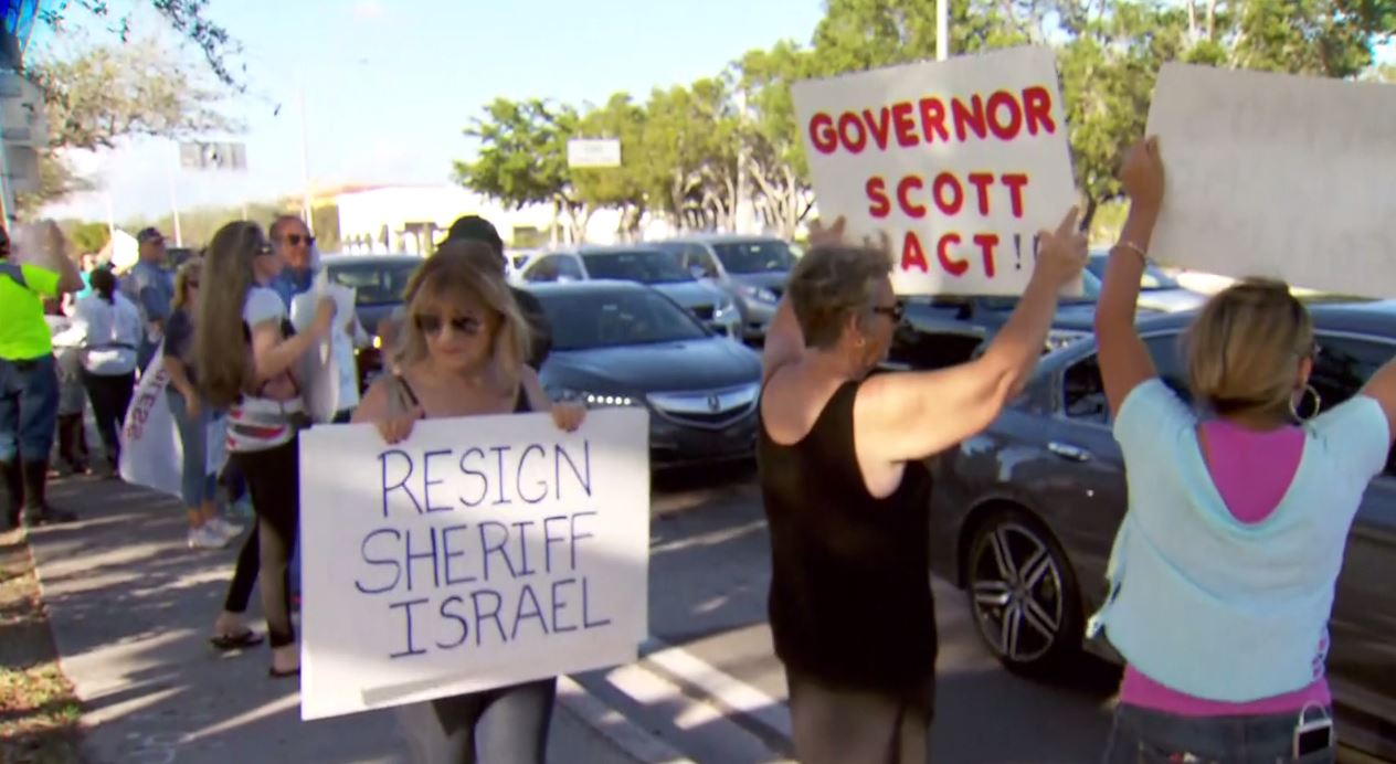 PHOTO: Protesters took to the streets of Coral Springs, Florida, on Feb. 24, 2018, to demand the resignation of Broward County Sheriff Scott Israel.