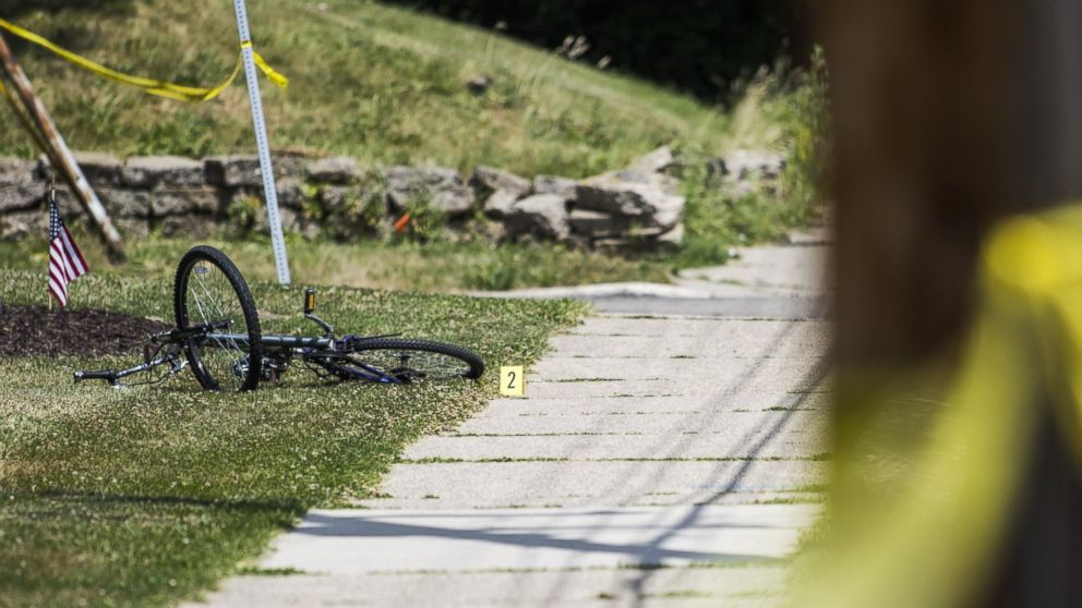 PHOTO: A bike is marked as evidence at the scene of a shooting on June 30, 2016 in Grand Rapids, Michigan.