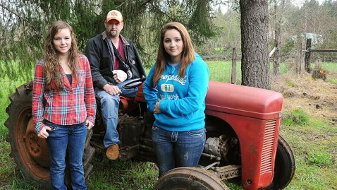 ap jeff smith mi 130410 wblog Teen Daughters Lift 3,000 Pound Tractor Off Dad