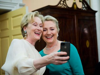 PHOTO: Actress Meryl Streep uses her iPhone to get a photo of her and Secretary of State Hillary Rodham Clinton following the State Department Dinner for the Kennedy Center Honors gala Saturday, Dec. ...