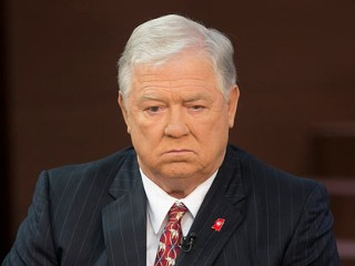 PHOTO: Haley Barbour, former governor of Mississippi, waits to speak during a Face the Nation television interview on the floor of the Tampa Bay Times Forum prior to the Republican National ...