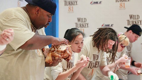 ht wild turkey eating contest 2011 ll 111123 wblog VIDEO: 100 Pound Black Widow Wins Inaugural Turkey Eating Competition