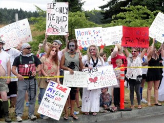 PHOTO: A group of zombies protest the eight members of Westboro Baptist Church from Topeka, Kan, not shown, who were protesting the military in DuPont, Wash. on July 27, 2012.