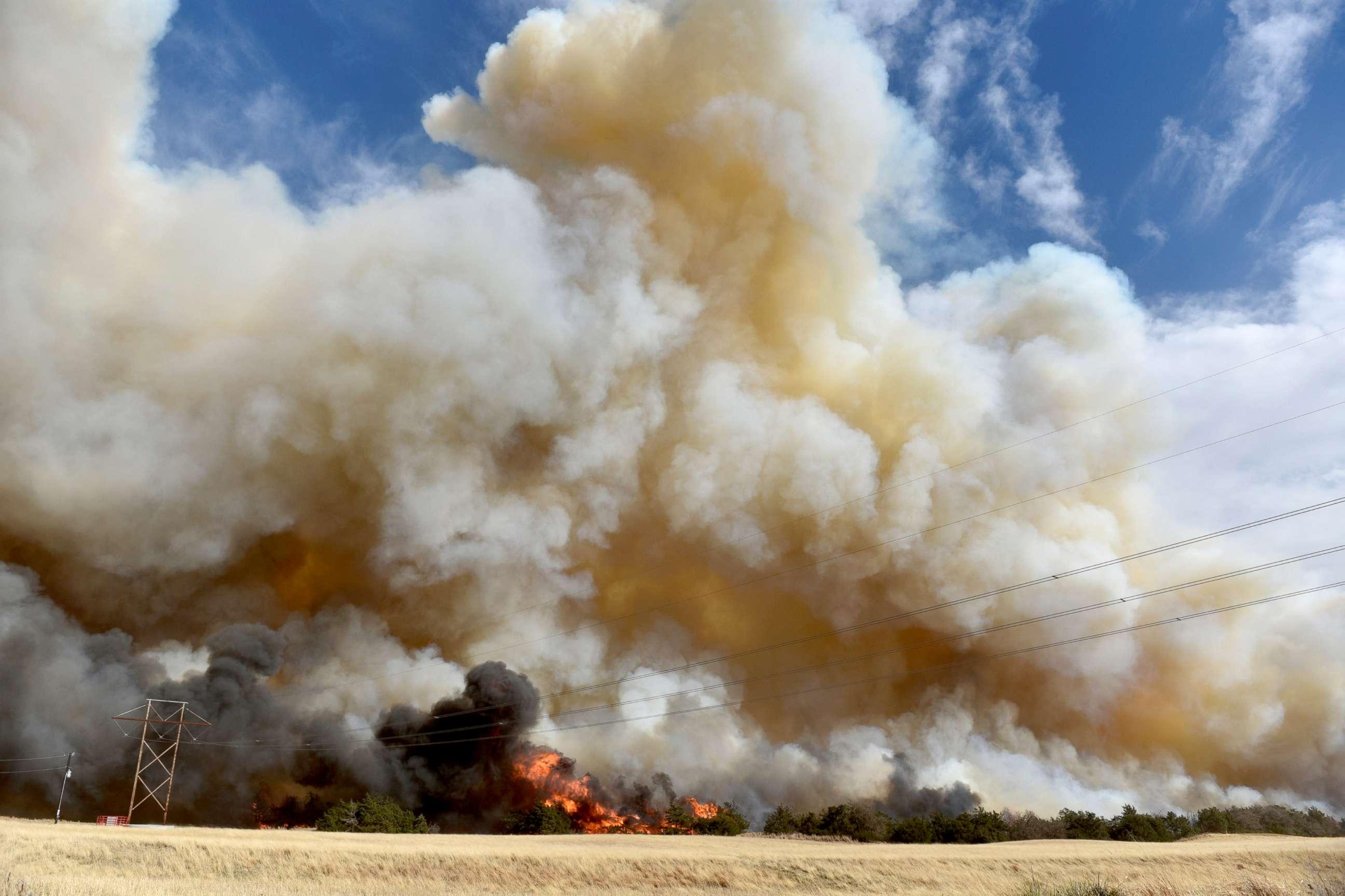 PHOTO: The Rhea fire burns through a grove of red cedar trees near Seiling, Oklahoma, April 17, 2018.
