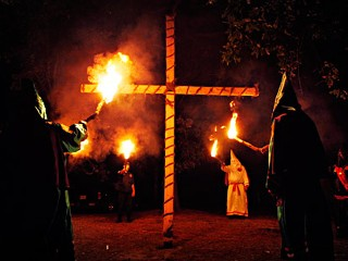 the racism of the ku klux klan and their burning of the cross Racism and the ku klux klan its members wore white robes and masks and adopted the burning cross as their symbol the klan members seemed to the ku klux klan.